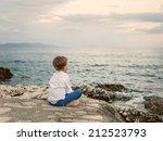 Little Boy Looks On The Sunset...