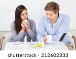 sick couple drinking lemon tea... | Shutterstock . vector #212602333