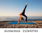 woman stretching in yoga... | Shutterstock . vector #212643763