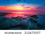 Sunrise Over A Rocky Coast