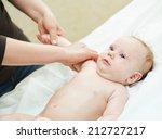 masseur making a massage to... | Shutterstock . vector #212727217