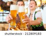 couple drinking wheat beer in... | Shutterstock . vector #212809183