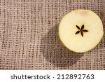 Apple Cut In Half On Jute Sack...