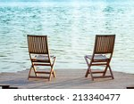 Two Adirondack Wooden Chairs O...