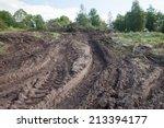 tractor tire tracks in muddy... | Shutterstock . vector #213394177