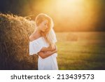 beautiful blond in field at... | Shutterstock . vector #213439573