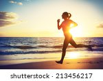 woman running on the beach at... | Shutterstock . vector #213456217
