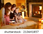 happy young family using a... | Shutterstock . vector #213641857