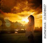 Silhouette Of Young Woman At...