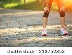 Tired Female Runner Taking A...