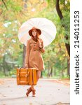 redhead girl with umbrella and... | Shutterstock . vector #214011253