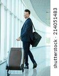 business traveler pulling... | Shutterstock . vector #214051483