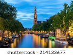 Stock photo westerkerk on the prinsengracht canal in amsterdam at twilight the netherlands 214133677