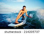 male surfboarder practicing... | Shutterstock . vector #214205737