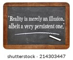 Small photo of reality is merely an illusion, albeit a very persistent one - a quote from Albert Einstein on a vintage slate blackboard