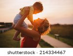 silhouette of a young mother... | Shutterstock . vector #214334467