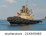 Tow Ship In The Harbor Of...
