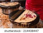 pancake made by a paris street... | Shutterstock . vector #214438447