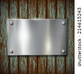 metal plate on a wooden wall   Shutterstock .eps vector #214615243