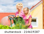 mother and daughter working in... | Shutterstock . vector #214619287