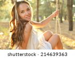 young woman is swinging on a... | Shutterstock . vector #214639363