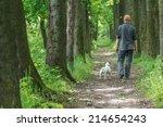 Stock photo man and dog walking on park 214654243