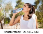 gorgeous latin athlete drinking ... | Shutterstock . vector #214812433
