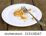 Dirty Empty Plate With Fork On...