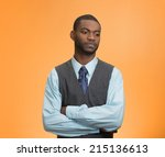 Small photo of Portrait, annoyed, grumpy executive business man, customer service representative avoiding eye contact, tired of fruitless conversation looking away, isolated orange background. Body language attitude