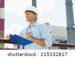male architect with clipboard... | Shutterstock . vector #215232817