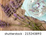 lavenders in water on blue... | Shutterstock . vector #215243893