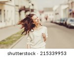 young girl posing in the street | Shutterstock . vector #215339953