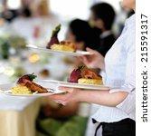 waitress carrying three plates...   Shutterstock . vector #215591317