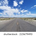 An Empty Desert Road Cuts...