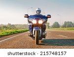 Biker In Helmet And Leather...