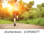 runner athlete running on... | Shutterstock . vector #215928277