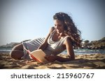girl reading a book at the beach | Shutterstock . vector #215960767