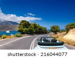 open road to the sea on the... | Shutterstock . vector #216044077