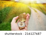 compass in the hand against... | Shutterstock . vector #216127687