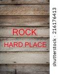 Wooden Signpost Saying Rock An...