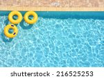 three yellow pool rings... | Shutterstock . vector #216525253