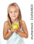 young girl holding apple seven... | Shutterstock . vector #216564823