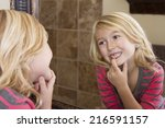 child looking in mirror and... | Shutterstock . vector #216591157