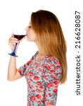 Small photo of Beautiful young girl drinking alcoholic tipple on white background