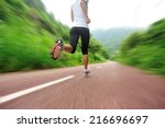 runner athlete running on... | Shutterstock . vector #216696697
