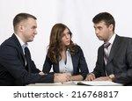 three business people discuss... | Shutterstock . vector #216768817