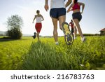 men and women jogging. | Shutterstock . vector #216783763