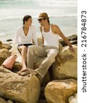couple sitting on the rocks at...   Shutterstock . vector #216784873