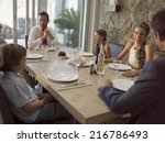 family at the dining table. | Shutterstock . vector #216786493