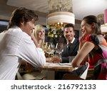 friends at a restaurant. | Shutterstock . vector #216792133
